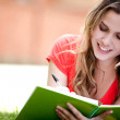 Woman studying outdoors — Stock Photo #7757727