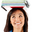 Student balancing books — Stock Photo