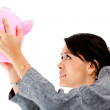 Woman with a piggybank — Stock Photo #7757925