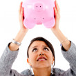 Woman with a piggybank — Stock fotografie