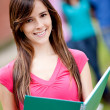 Female student smiling - Stock Photo