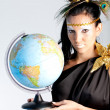Greek goddess with a globe — Stock Photo