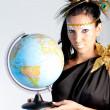 Greek goddess with a globe — Stock Photo