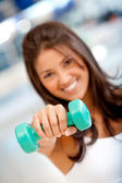Woman with freeweights — Stock Photo