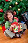 Boy with christmas gift — Stock Photo