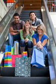 Shopping on escalators — Stock Photo