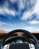 Steering wheel on a highway — Stock Photo