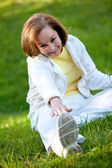 Woman stretching at the park — Stock Photo