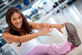 Woman stretching at the gym — Stock Photo