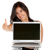 Woman with laptop and thumbs up — Stock Photo