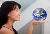 Business woman holding earth — Stock Photo