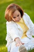 Retired woman stretching outdoors — Zdjęcie stockowe