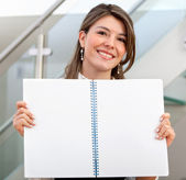 Woman displaying a notebook — Stock Photo