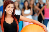 Woman with a pilates ball — Стоковое фото