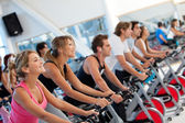 Gym on spinning machines — Stock Photo