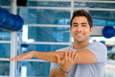 Man stretching his arm — Stock Photo
