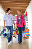 Happy shopping couple — Stock Photo