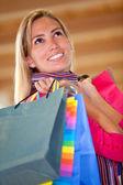 Pensive shopping woman — Stock Photo