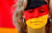 German flag - female face — Stock Photo