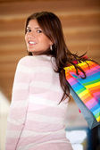 Shopping girl smiling — Stock Photo