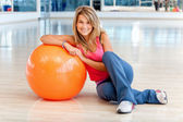 Woman at the gym smiling — Stock Photo