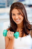 Gym woman with free-weights — Stock Photo
