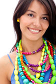 Woman with colorful necklaces — Stock Photo