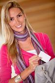 Woman taking a card from her purse — Stock Photo