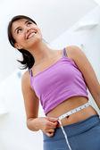 Woman measuring her waist — Stock Photo