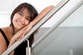 Woman leaning on a handrail — Foto Stock