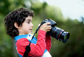Boy playing with a camera — Stock Photo