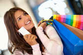 Shopping woman with a credit card — Stock Photo