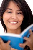 Woman reading a book — Foto de Stock
