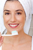 Woman holdin a toothbrush — Stock Photo