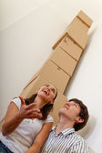 Couple with a pile boxes — Stock Photo