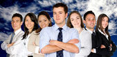 Confident business man and his business team — Foto Stock