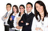 Business team lead by a business woman — Stock Photo