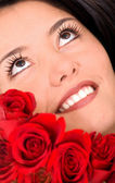 Beauty portrait of a girl with roses — Stock Photo