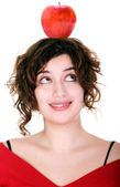 Girl with an apple on her head — Stock fotografie