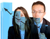 Businesspeople watching their business growth — Stock Photo