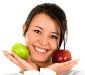 Girl holding apples — Stock Photo