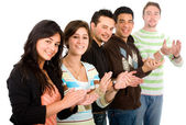 Group of casual young applauding — Stock Photo