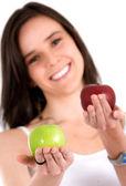 Beautiful girl holding apples — Stock Photo
