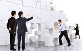 Business teamwork - business men making a puzzle — Stock Photo