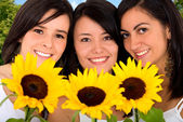 Beautiful girls with sun flowers — Stock Photo