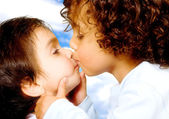 Cute baby brothers kissing — Stock Photo