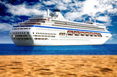 Cruise liner by the beach — Stock Photo