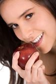 Beautiful girl eating an apple — Stok fotoğraf