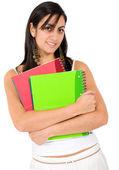 Female student holding notebooks — Stock Photo