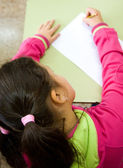 Girl in primary school doing a test — Stock Photo